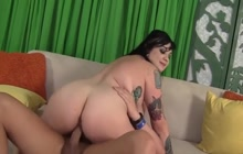 Tattooed fatty riding on a cock