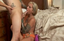 Inked mom fucking with her son's friend
